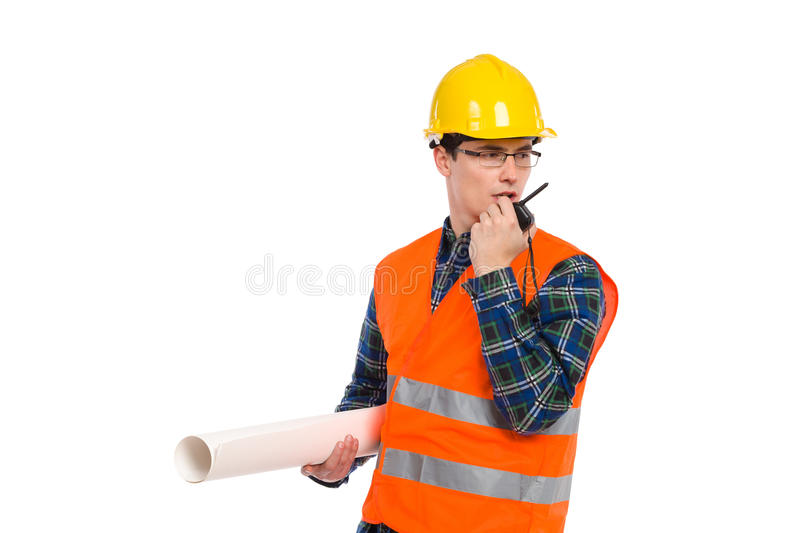 Engineer with walkie-talkie. Construction worker in glasses holds paper roll and using walkie-talkie. Full length studio shot isolated on white stock images