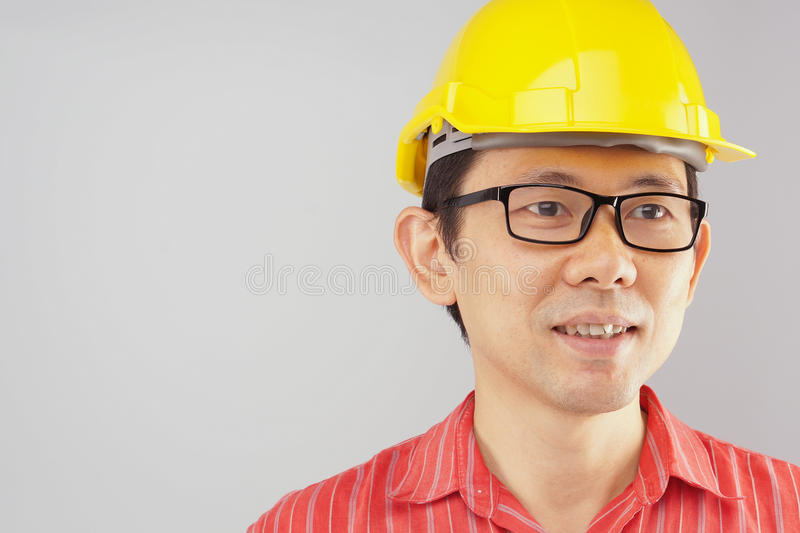 Engineer wear red shirt and yellow hat with spectacles royalty free stock photography