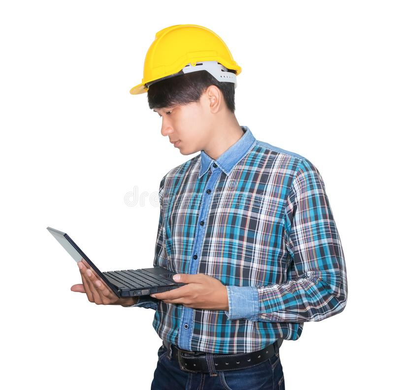 Free Engineer While Holding Using Laptop And Head Wear White Safety Helmet Plastic.Concept Work Construction On White Background Royalty Free Stock Photo - 135660625