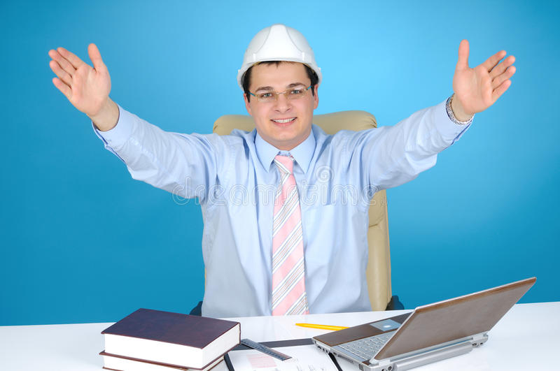 An engineer with white hard hat at work stock images