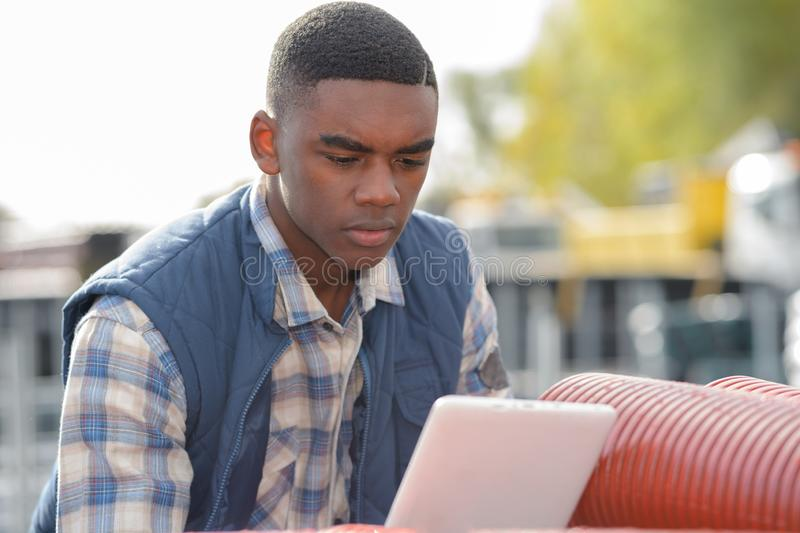Engineer wit tablet outdoors stock photography