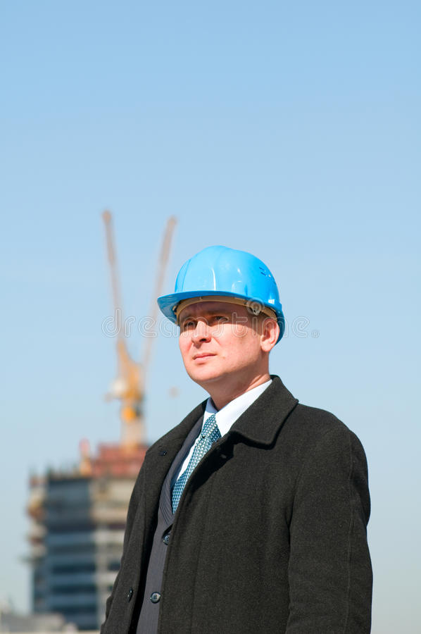 Free Engineer With Blue Hardhat Stock Photos - 13758073