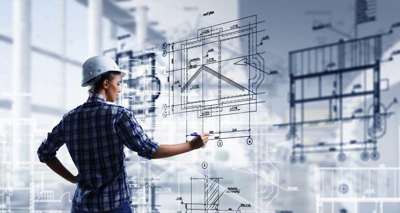 Engineer woman draw layout . Mixed media stock image