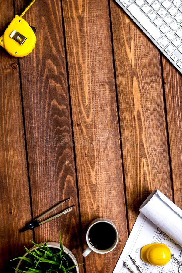 Engineer wooden working desktop with drawings apartments top vie royalty free stock images