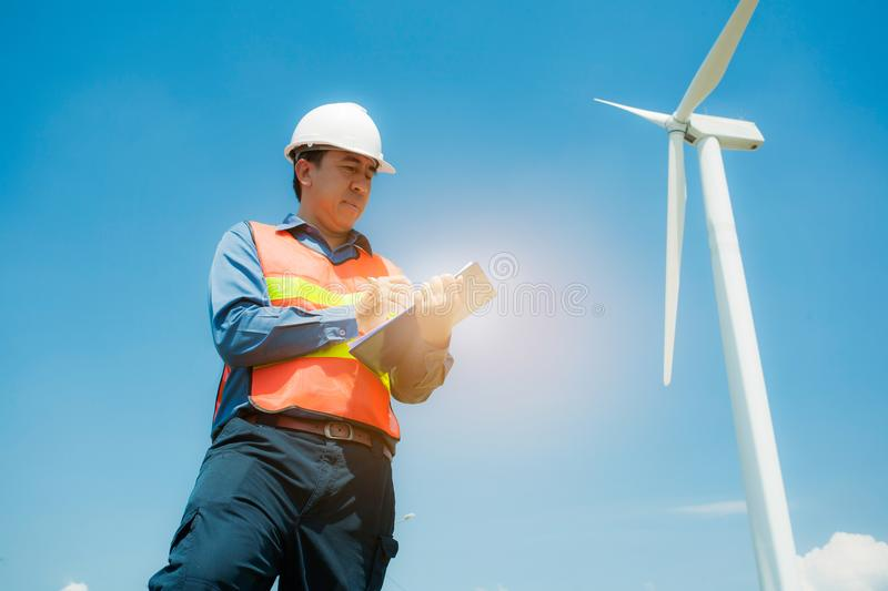 An Engineer at Work wind turbine station,wind enegy concept royalty free stock photos