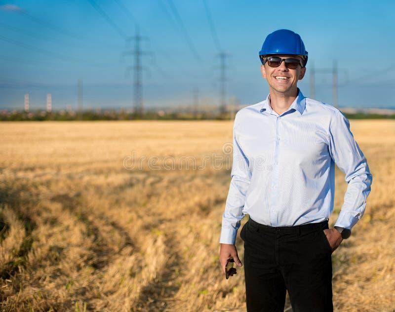 Engineer or worker smiles in protective helmet stock photo