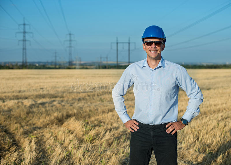 Engineer or worker smiles in protective helmet stock images
