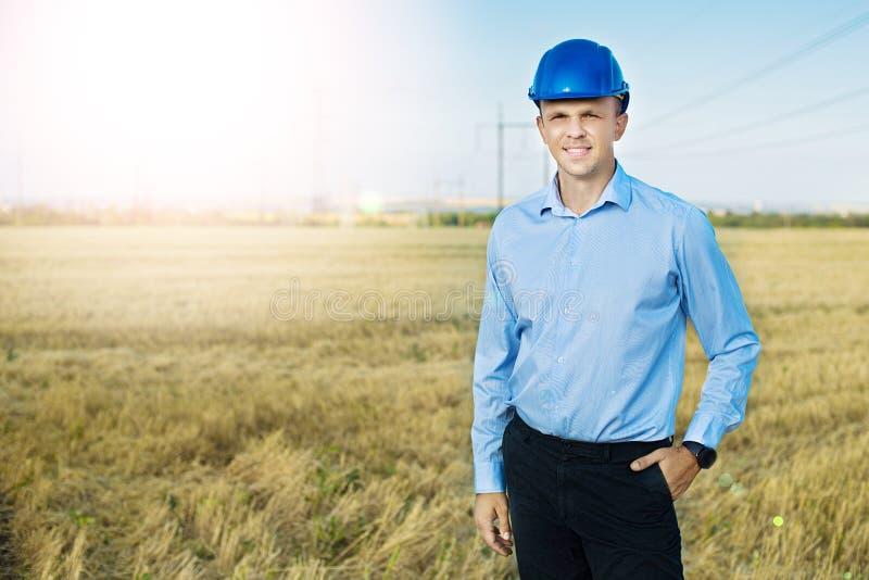 Engineer or worker smiles in protective helmet royalty free stock photos