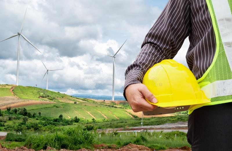 Engineer worker at wind turbine power station stock image