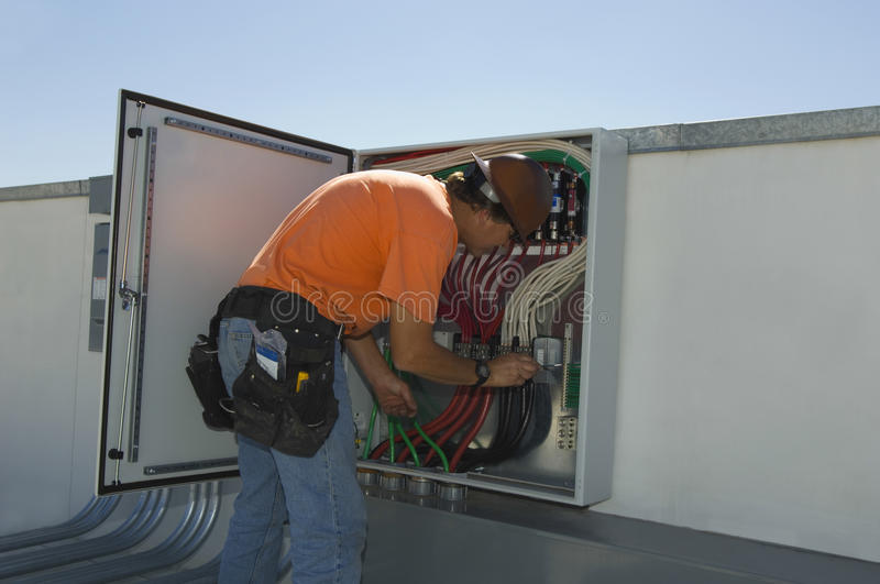 Engineer Working On Electrical Box. At solar power plant stock photo
