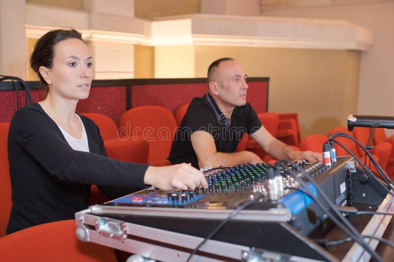Engineer working at mixing desk in recording studio royalty free stock photo
