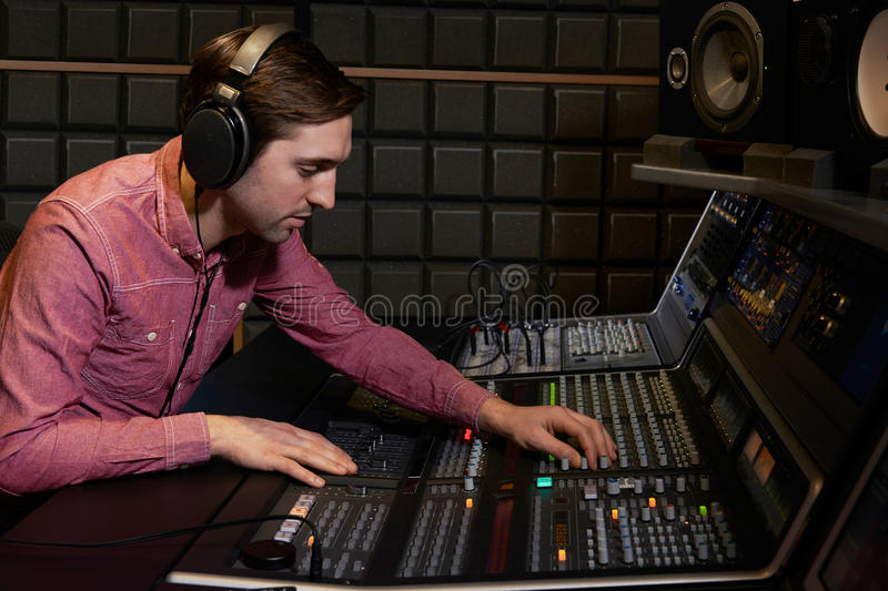 Engineer Working At Mixing Desk In Recording Studio royalty free stock photography