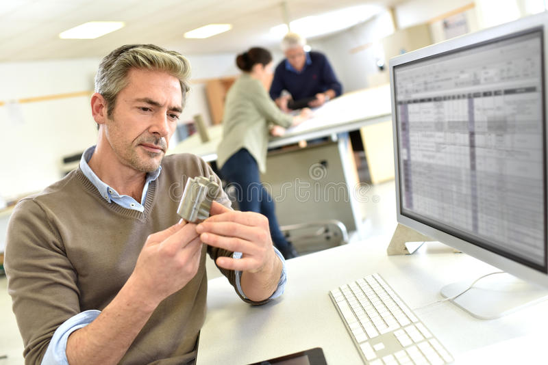 Engineer working on new invention royalty free stock photography