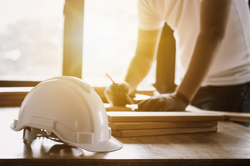 engineer working in office, writing and planing construction building stock photos