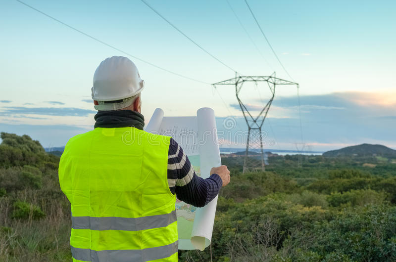 Engineer working on power lines royalty free stock photography
