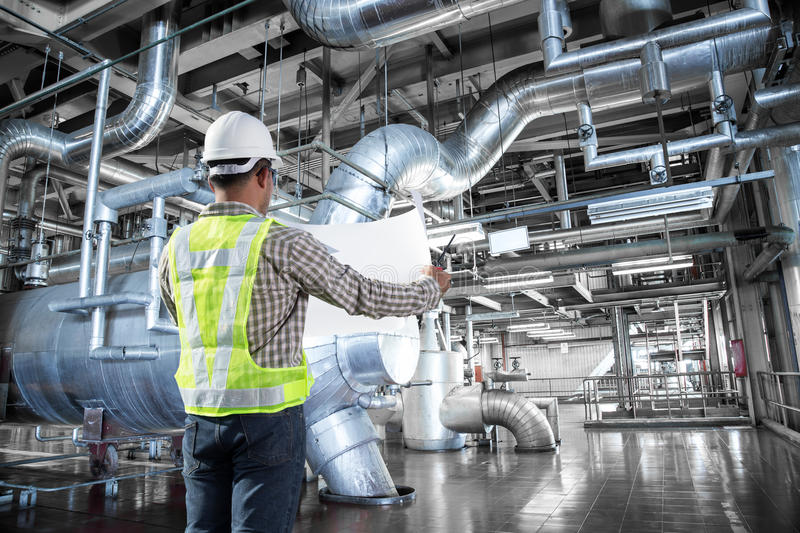 Engineer working at thermal power plant factory.  royalty free stock image