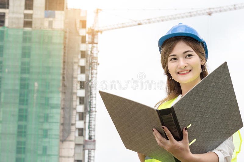 Engineer working and writing report royalty free stock images