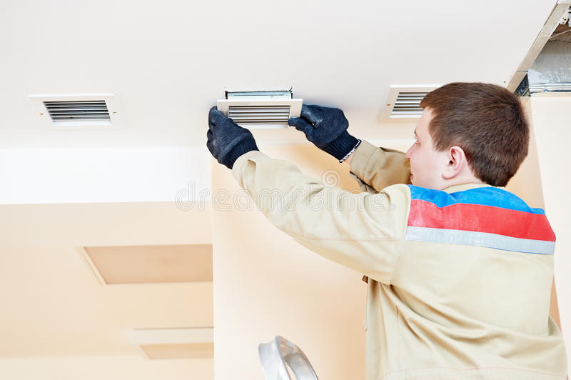 Engineer works with ventilation royalty free stock photo