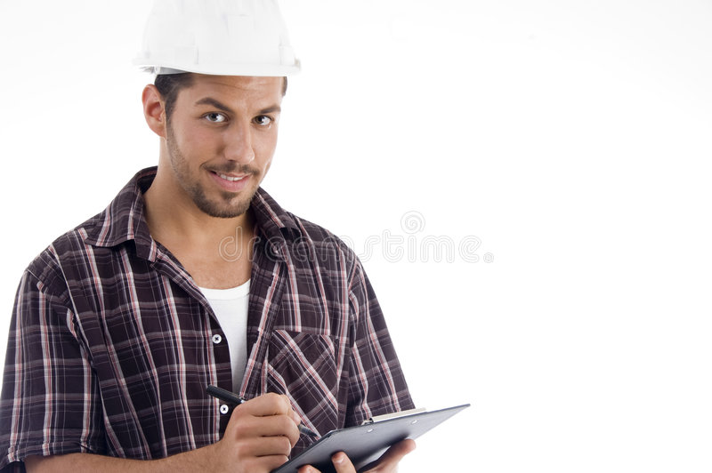 Download Engineer Writing On Pad And Looking At Camera Stock Photo - Image: 7361690