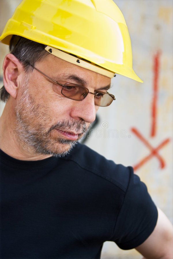 Engineer in a yellow hard hat. Construction worker in a yellow hard hat royalty free stock image