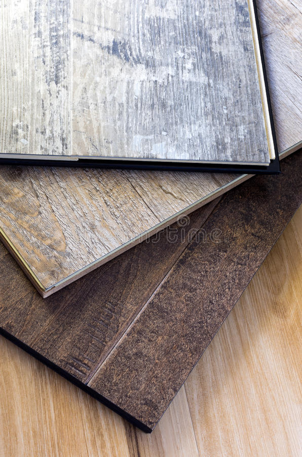 Engineered Hardwood and Vinyl Floor Planks. Engineered tongue in groove hardwood and vinyl floor planks of various styles and finishes in a stack royalty free stock photography
