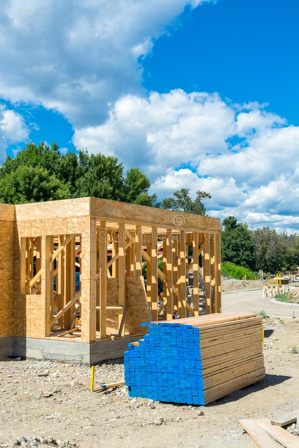 Wooden frame of new building with lumber materials prepared for construction. Engineered lumber materials prepared for building construction. Tow by four lumber royalty free stock images