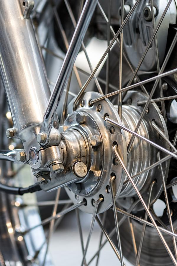 Engineered motorcycle wheel parts. Disc brake suspension and spo. Kes in close-up. Mechanical engineering design and technology image stock photos