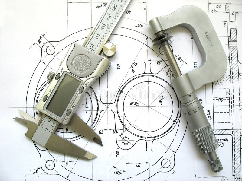 Engineering 3. Digital caliper and micrometer on technical drawing royalty free stock photo