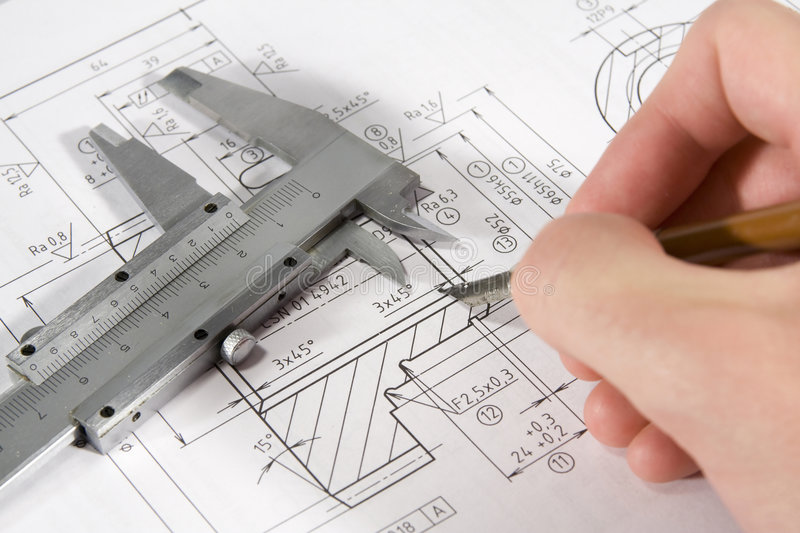 Engineering. Drawing of gearwheel with pen in right hand stock photo