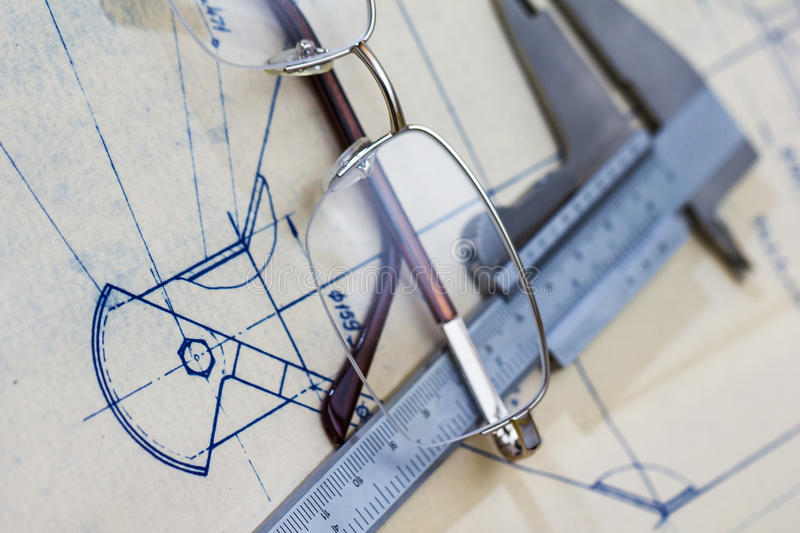 Engineering blueprint with glasses and gauge. Very detailed mechanical engineering blueprint with glasses and gauge royalty free stock photo