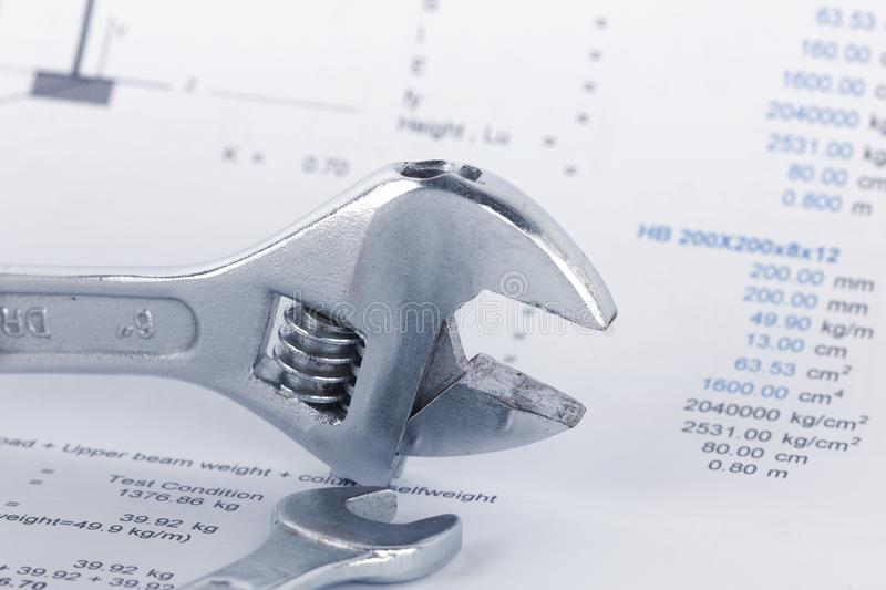 Engineering calculation documents with wrench. Maintencance concept royalty free stock image