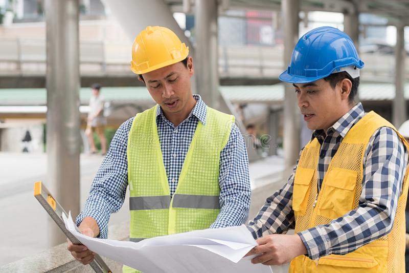 engineering construction teamwork concept : professional engineer work industrial project site royalty free stock images