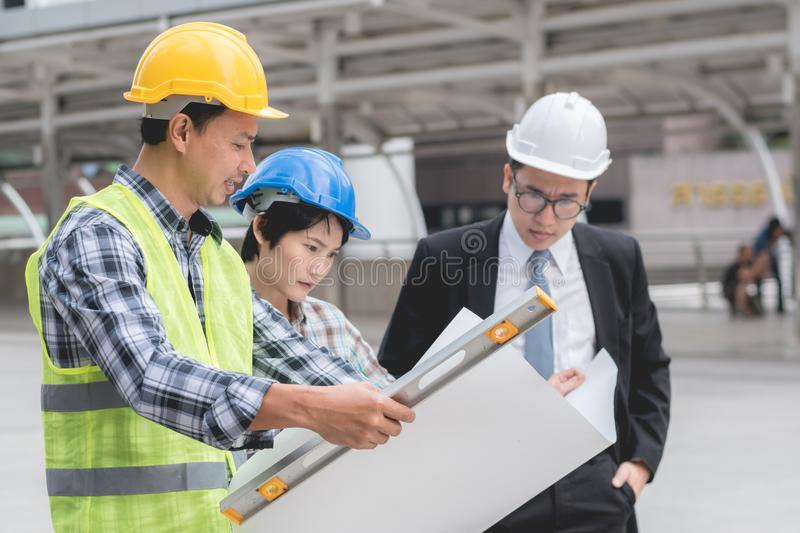 Engineering construction teamwork concept : professional engineer work industrial project site. Selective focus royalty free stock image