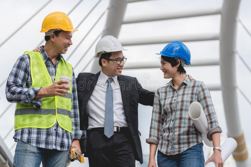 Engineering construction teamwork concept : professional engineer work industrial project site. Selective focus stock image