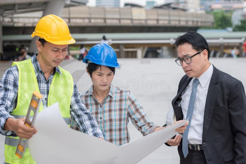 engineering construction teamwork concept : professional engineer work industrial project site stock image