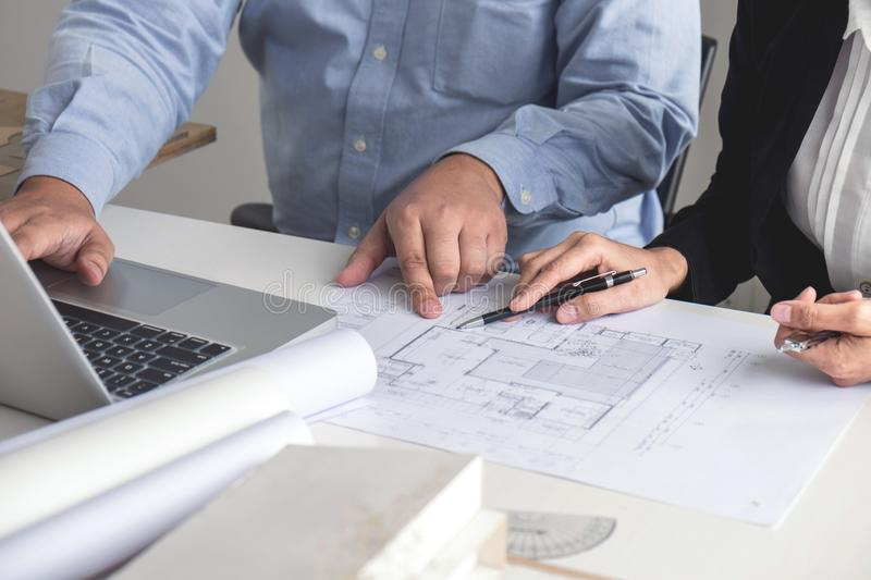 Hands Of Engineers Working On Blueprint At A Workplace