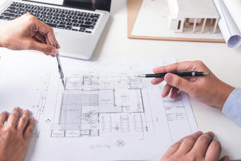 Engineering or Creative architect in construction project, Engineers hands working with compasses on construction blueprint build stock photography