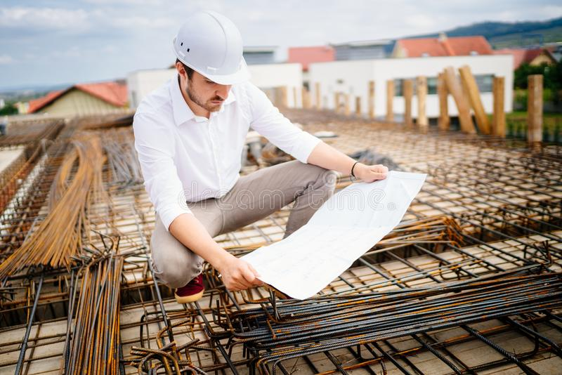 Engineering - civil construction engineer working on site stock images