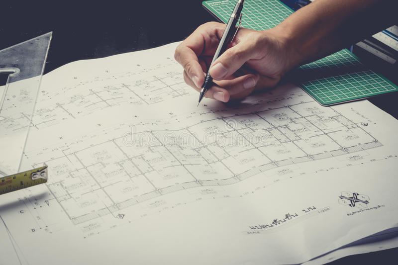 Engineering diagram blueprint paper drafting project sketch. Architectural,selective focus,vintage filter royalty free stock photo