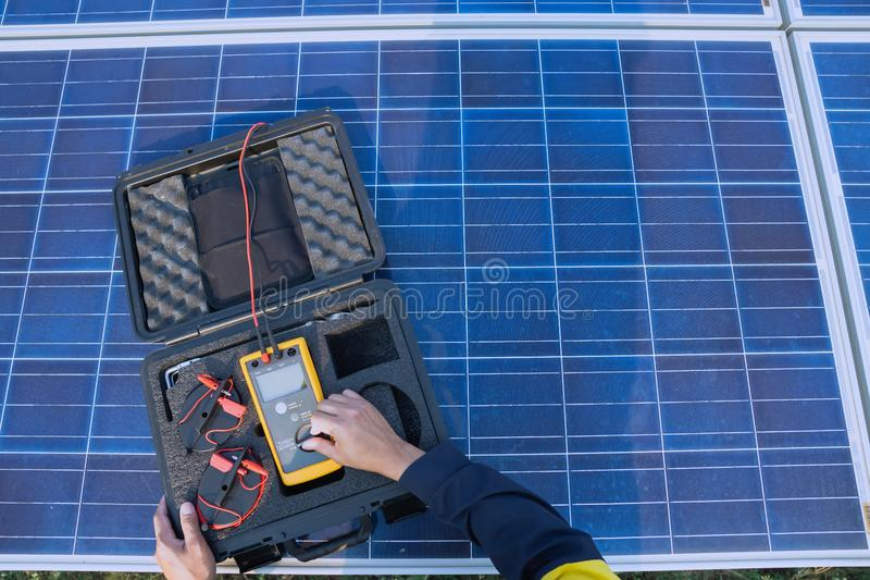 Engineering is doing preventive maintenance for solar panels to generate electricity efficiently, alternative electricity source, stock image