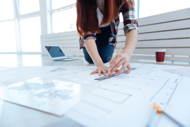 Engineering draft being drawn by a woman stock photos