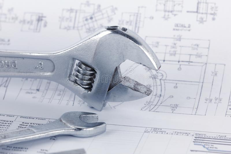 Engineering drawing documents with wrench. Maintencance concept stock image