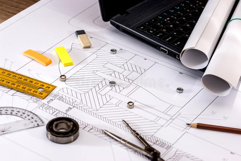 Engineering drawings of parts with a laptop. Engineering drawings of parts with a laptop stock photography