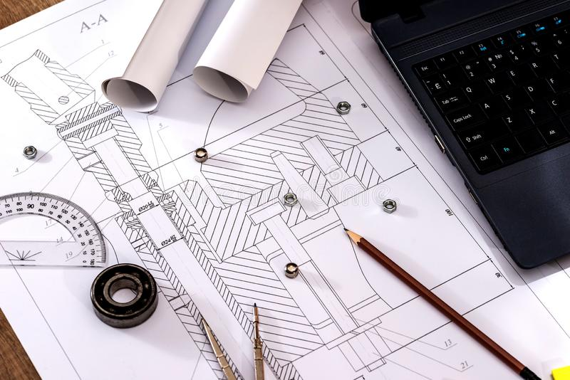 Engineering drawings of parts with a laptop. Engineering drawings of parts with a laptop royalty free stock photos