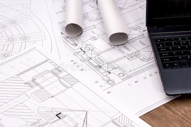 Engineering drawings of parts with a laptop.  royalty free stock photography