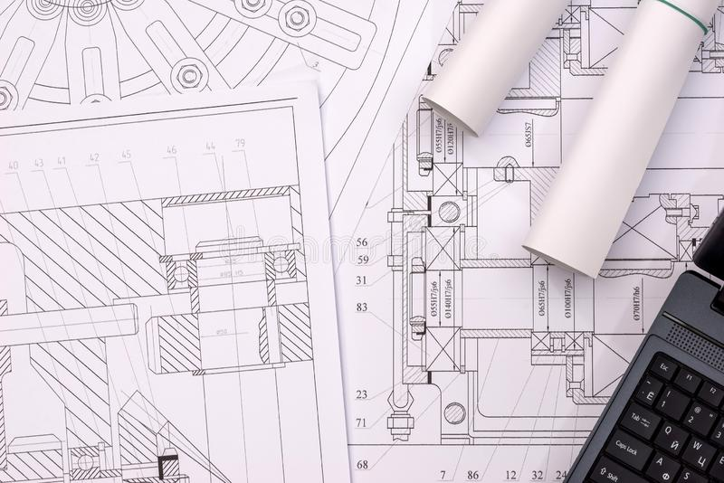 Engineering drawings of parts with a laptop. Engineering drawings of parts with a laptop royalty free stock image