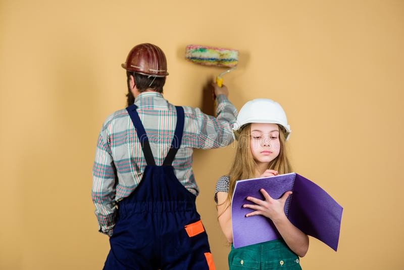 Engineering education. construction worker assistant. man with little girl. Family. Industry. Tools for repair stock photography