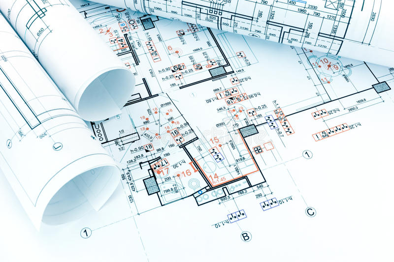 engineering electricity technical project with rolls of architectural blueprints stock photo
