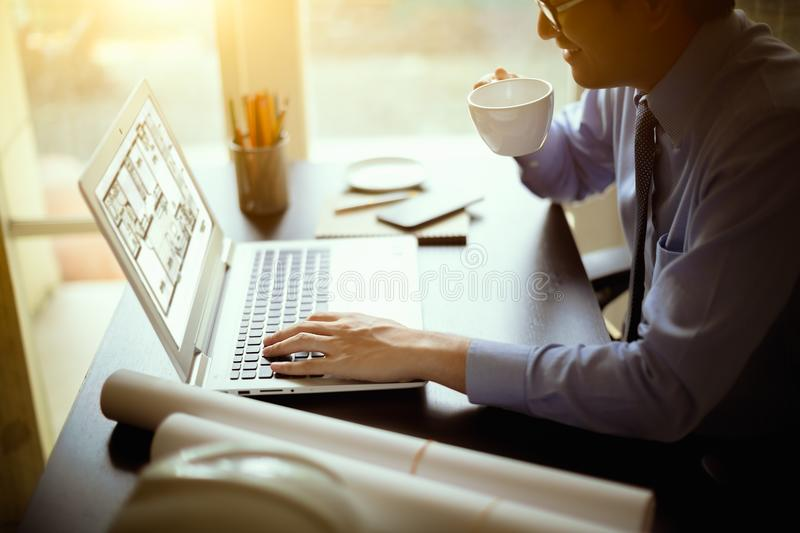 Engineering. Using laptop for create home plans stock image