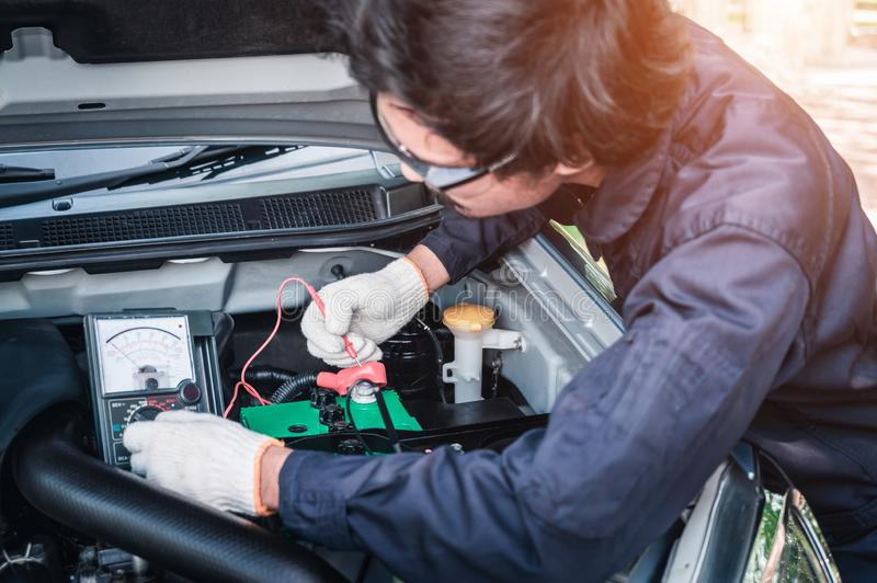 Engineering interface against mechanic changing car battery royalty free stock photos